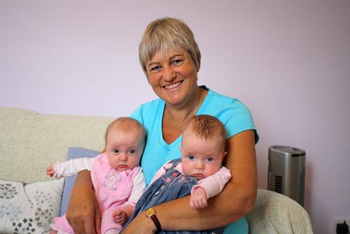 Linda holding twins